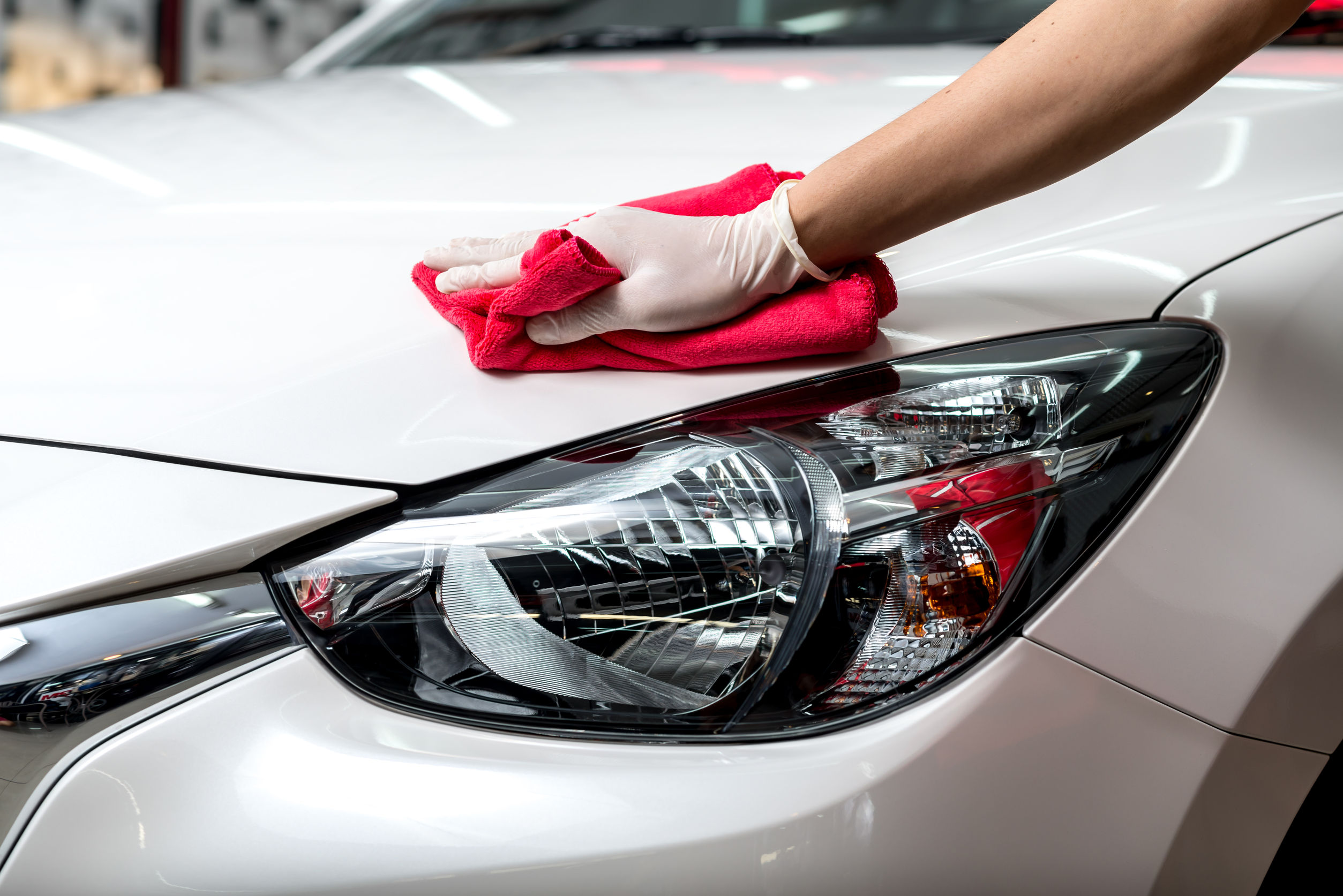 54195374 - car polishing series : worker cleaning white car